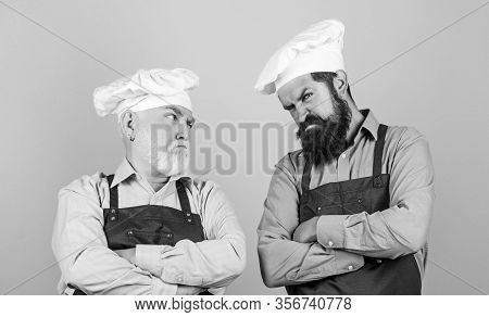 Mature Bearded Men Professional Restaurant Cooks. Family Restaurant. Chef Men Wear Aprons. Father An
