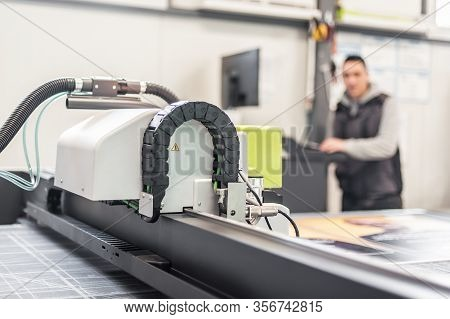 Technician Works On Large Cnc Computer Numerical Control Cutting Machine