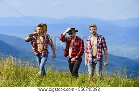 Life Is A Song. Group Of People Spend Free Time Together. Men With Guitar In Checkered Shirt. Hiking