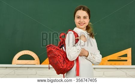 Kid Fashion. Back To School. Happy Girl Carry Backpack At Blackboard. Math Lesson Classroom. Smart H