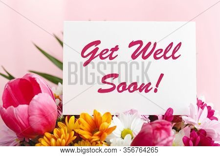 Get Well Soon Card In Flower Bouquet On Pink Background. Stock Photo Mock Up For Text.
