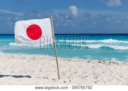 Japanese Flag On The Background Of The Sea