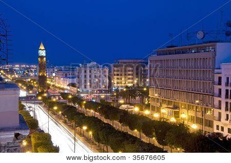 Clock Tower avenue Habib Bourguiba Ville Nouvelle Tunis Tunisia Africa with car night light streaks poster
