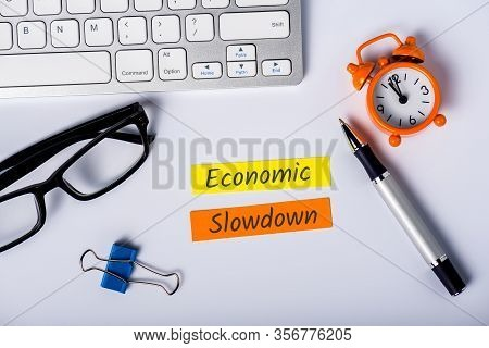 Economic Slowdown - Message At Busninessman Workplace. High Unemployment And Economic Stagnation