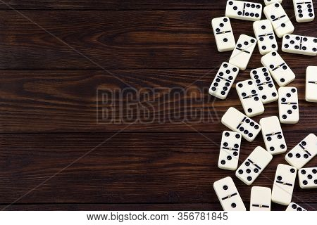 Dominoes Game On A Wooden Table, Brown Background. Board Game Domino. Gambling.