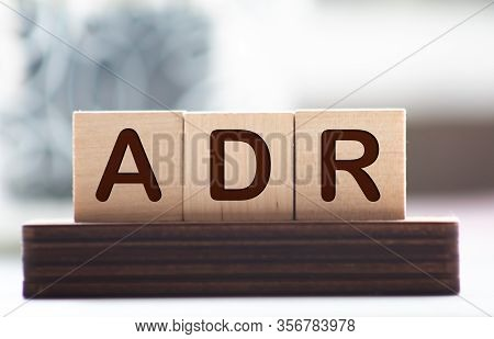 Letter Block In Word Adr Abbreviation Of Adverse Drug Reaction On Wood Background