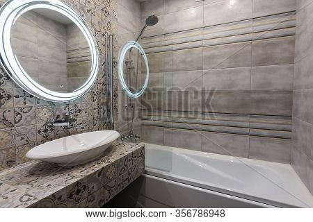 Beautiful Modern Bathroom, View Of The Washbasin And Bathtub