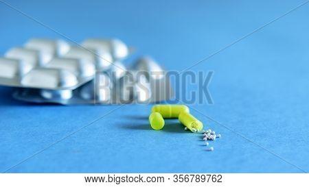 Packs Of Anti Inflammatory Pills On The Blue Background. Anti Virus Medicine. Stay Safe.
