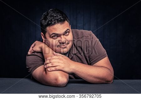 Cheerful Latino Man In A Casual Pose