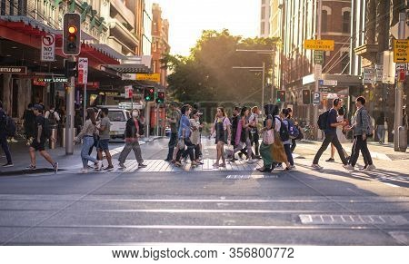 Sydney People With Face Mask Covered Crossed Street In City, Covid 19 Sickness Outbreak Situation In