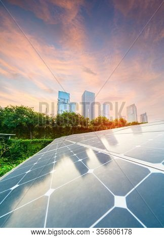 Solar Panel Photovoltaic installation with urban landscape landmarks, alternative electricity source, Sustainable Resources Concept.