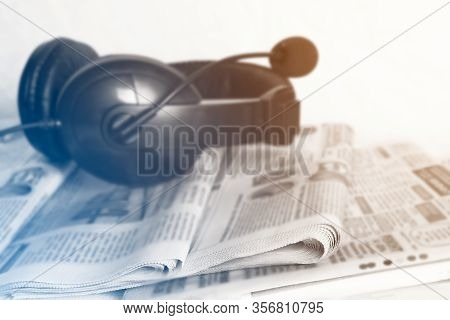 News Newspapers, Voip Headset On The Desktop In The Office, Media Concept