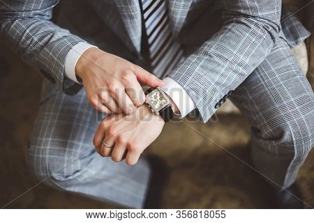 The Businessman Looking At His Watch Punctuality.