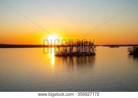 Sunset On The Banks Of The Dnieper River Among Trees In Ukraine In The Dnieper Cities In Spring