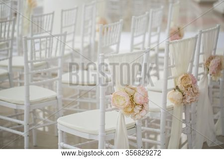 Wedding Decorations Flowers On Chairs. Wedding Exit Registration, White Chairs Decorated For Wedding