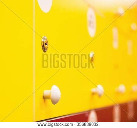 Lockers In The Locker Room. Bright Yellow And Red Doors.