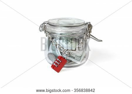 Us Dollar Bills In The Glass Jar, Locked By Chain And Master Key. Money In A Pot. Home Banking Conce