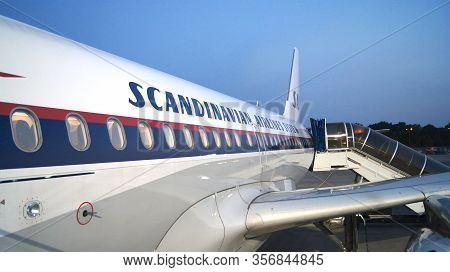 Berlin, Germany - Jul 03rd, 2015: View Of The Wing And Engine Of The Aircraft During Boarding