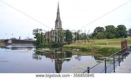 Copenhagen, Denmark - Jul 04th, 2015: St Albans Anglican Church And A Reflection In The Water During
