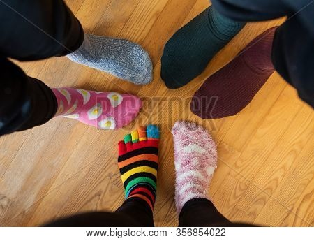 Funny Family Legs In Mismatched Socks.  Social Networks Photo For World Down Syndrome Day, March 21
