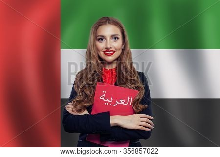 Happy Woman Student With Red Book On The Uae Flag Background. United Arab Emirates, Travel And Learn