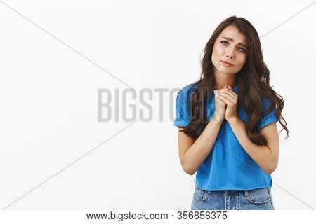Tenderness, Romance Concept. Charming Romantic, Cute Brunette Girl In Blue T-shirt, Hold Hands Toget