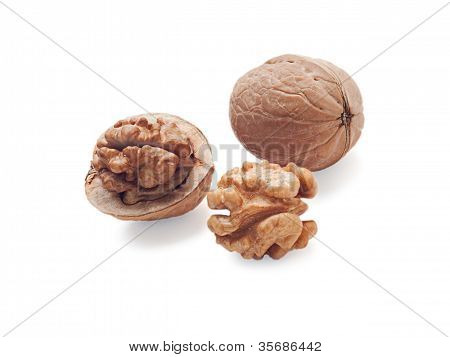 Walnut And A Cracked Walnuts  Isolated On The White Background