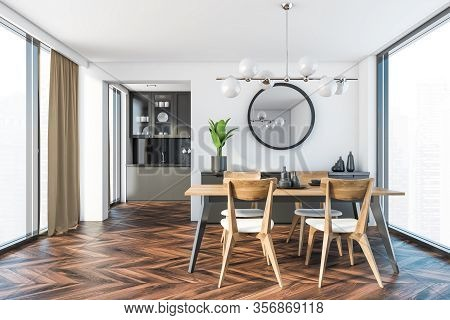 Interior Of Stylish Dining Room With White Walls, Dark Wooden Floor, Panoramic Windows With Blurry C