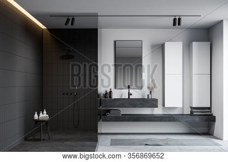 Interior Of Modern Bathroom With White And Gray Tiled Walls, Concrete Floor, Massive Stone Sink With