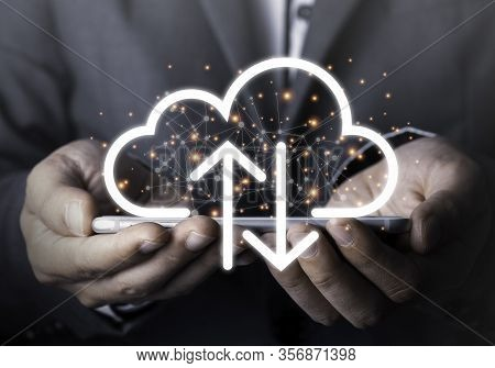 Businessman Holding Mobile Phone Which On The Top Of Phone Has Upload And Download Cloud Space Compu