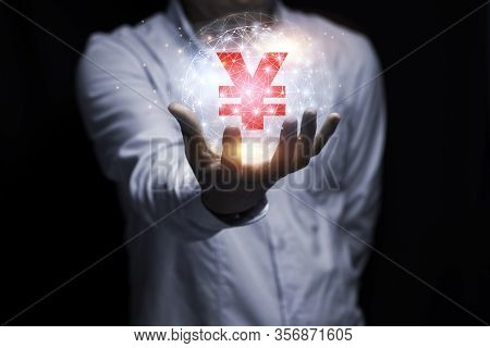 Businessman Hand Holding Yuan Or Yen Sign With Sunlight And Black Background. Yuan And Yen Money Is