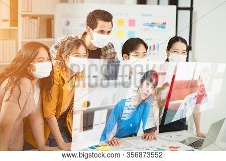 Group Of Office Worker Wearing Mask Having Teleconference Or Video Conference Calls In The Covid 19