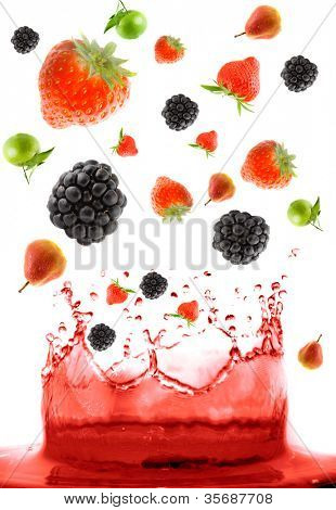 berry falling in juice. Isolation