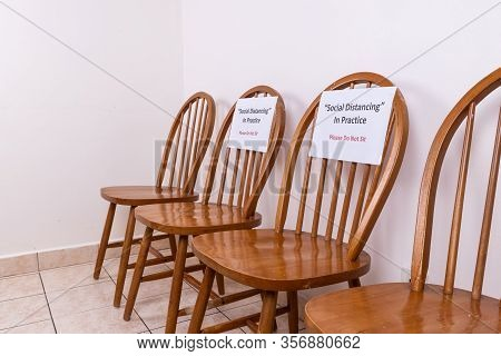 Chairs With Social Distancing & Do Not Sit Sign, To Discourage Close Proximity Between People To Con