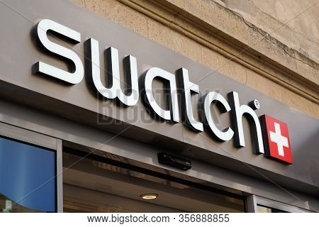 Bordeaux , Aquitaine / France - 09 18 2019 : Sign Of Swatch On Building Facade Swiss Watch Company