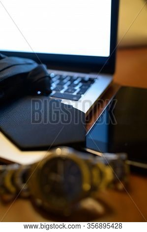 Black Tie On Laptop And Next To Smart Phone.