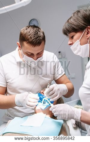 Dentists Are Working In Modern Stomatology Clinic. Stomatological Instrument In The Dentist Clinic.