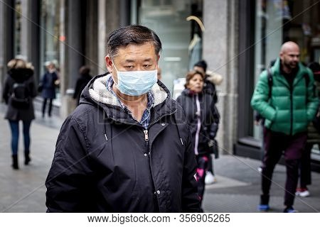 Madrid, Spain  - March 3: Unidentified Man Wearing Mask To Protect Himself And Others From Coronavir