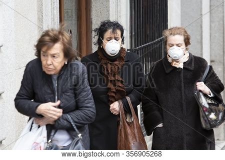 Toledo, Spain  - March 5: Unidentified Women Wearing Masks To Protect Themselves And Others From Cor