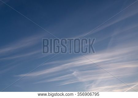 Blue Sky, Slightly Cloudy. There Are Delicate, Semi-transparent Feathery Clouds In The Sky. They Str