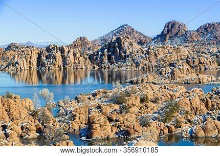 Winter At Watson Lake In Prescott Arizona With The Granite Dells And A Blue Sky Reflecting In The Wa