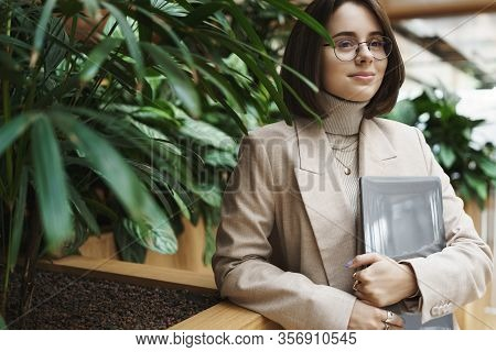 Career, Work And Women Concept. Close-up Portrait Of Successful Young Woman In Beige Jacket Waiting