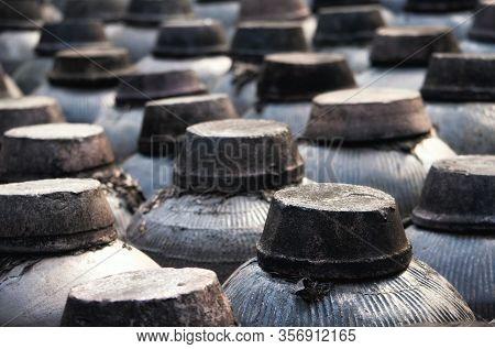 Many Stone Pots Holding The Xuchang Soy Sauce In Tongxiang Wuzhen East View In Zhejiang Province.
