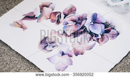 Floral Artwork. Creative Hobby Leisure. Watercolor Purple Flowers Painting On White Canvas.