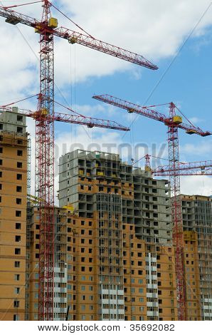 Construction of skyscrapers on a background of the dark blue sky