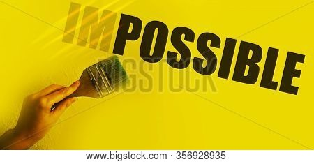 Impossible Into Possible Word Transforming With Paintbrush In Womans Hand . Motivation Startup Conce