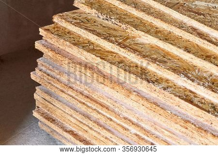 Osb Slab Building Material Made From Reborn Sawdust. They Are Stacked. Close-up.