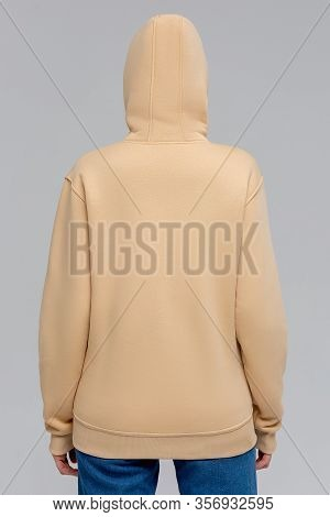 Woman In Gold Hoodie, Mockup For Logo Or Branding Design