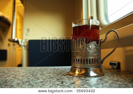 Travel in train with a glass of hot tea