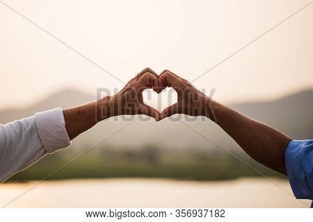 A Happy Senior Couple Asian Old Man And Woman Showing Heart Sign, Love Symbol, Happy Marriage. Senio